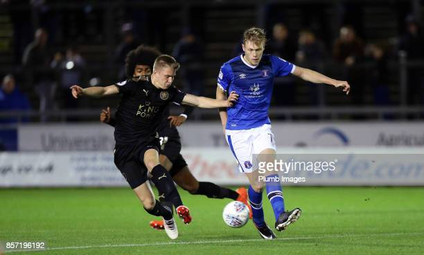 Josh Knight of Leicester City in action with Sam Cosgrove of Carlisle United during the EFL Checkatrade Trophy tie between Carlisle United and...