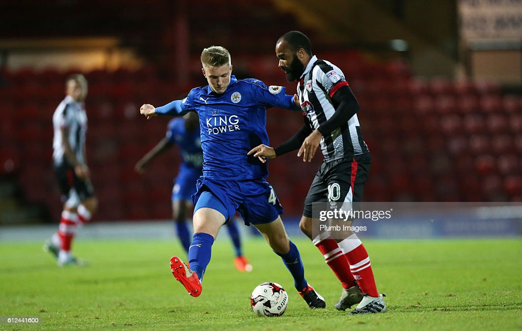 Josh Knight of Leicester City with Dominic Vose of Grimsby Town during the checkatrade Trophy match between Grimsby Town and Leicester City at Blundell Park on September 04, 2016 in Grimsby, United Kingdom.
