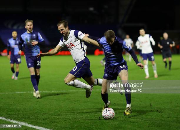 Josh Knight of Wycombe Wanderers looks to break past Harry Kane of Tottenham Hotspur during The Emirates FA Cup Fourth Round match between Wycombe...