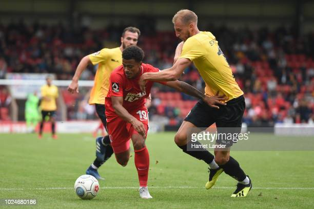 Josh Koroma of Leyton Orient is challenged by Tim Schmoll of Dover Athletic during the Vanarama National League match between Leyton Orient and Dover...