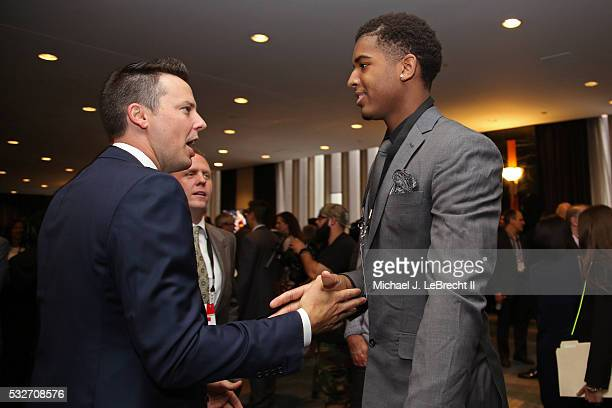 Josh Kroenke of the Denver Nuggets talks to NBA Draft Prospect Marquese Chriss during the 2016 NBA Draft Lottery at the New York Hilton in New York...