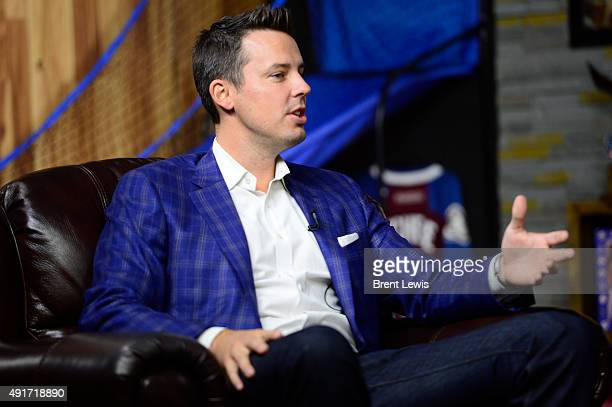 Josh Kroenke owner of Kroenke Sports Enterprises sits down on the couch with Woody Paige and Les Shapiro on The Sports Show on October 6 2015 at The...