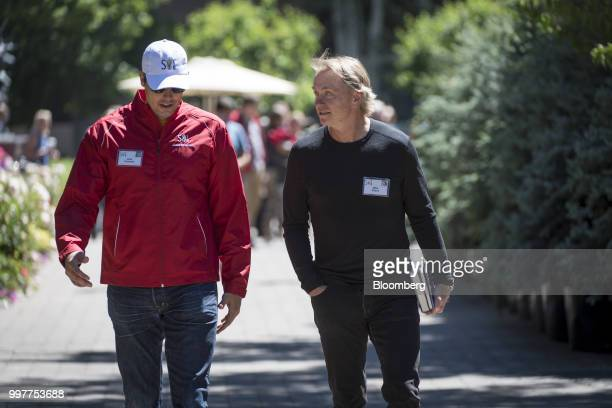 Josh Kroenke vice chairman of Kroenke Sports Entertainment LLC left and Wes Edens cochairman and cofounder of Fortress Investment Group LLC walk the...
