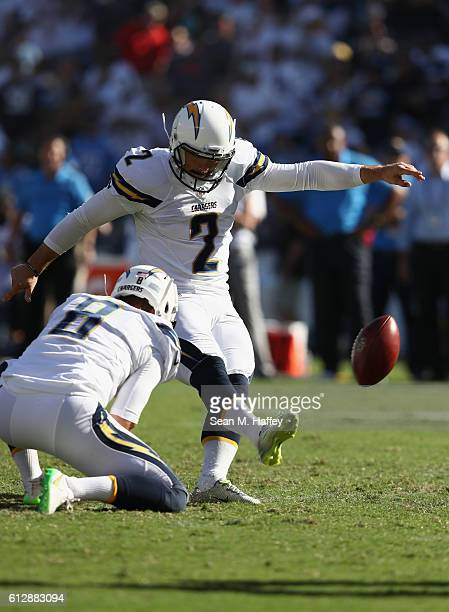 Josh Lambo kicks a fieldgoal as Drew Kaser of the San Diego Chargers holds during a game against the Jacksonville Jaguars at Qualcomm Stadium on...