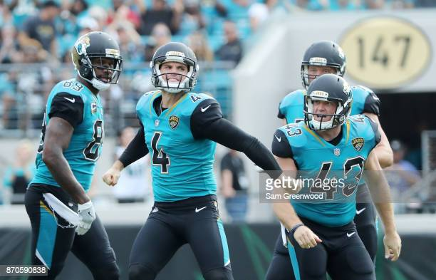 Josh Lambo of the Jacksonville Jaguars celebrates with his teammates after he connected on a 56yard field goal in the first half of their game...
