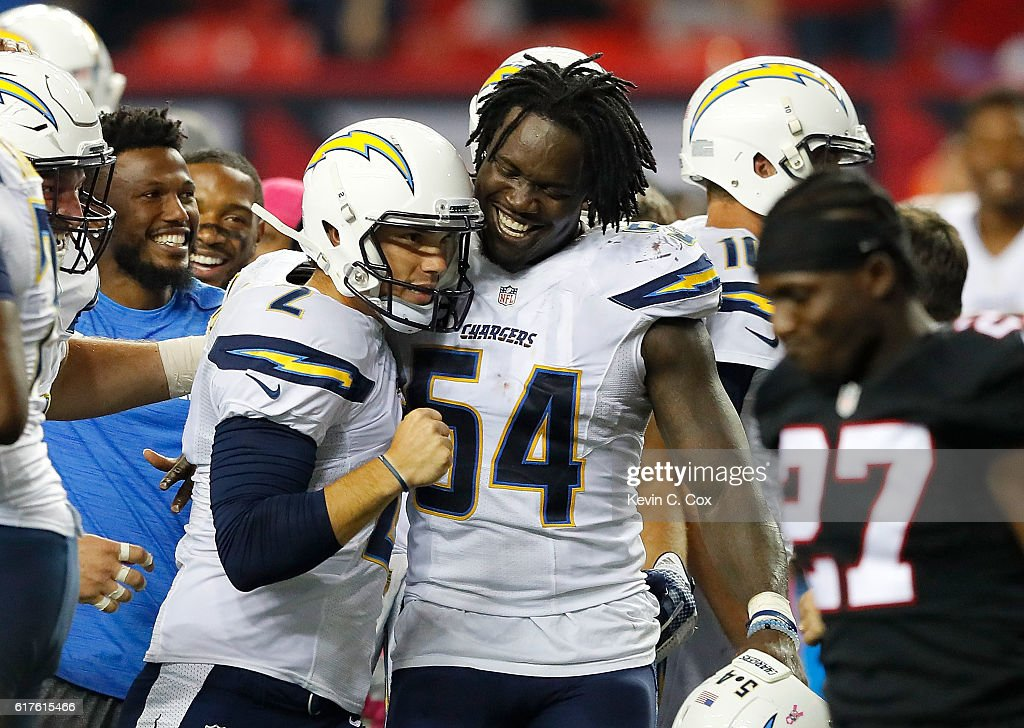 Josh Lambo #2 of the San Diego Chargers celebrates kicking the game-winning field goal in their 33-30 overtime win over the Atlanta Falcons with Melvin Ingram #54 at Georgia Dome on October 23, 2016 in Atlanta, Georgia.