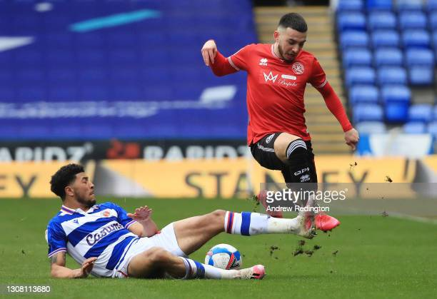 Josh Laurent of Reading FC and Ilias Chair of Queens Park Rangers battle for the ball during the Sky Bet Championship match between Reading and...