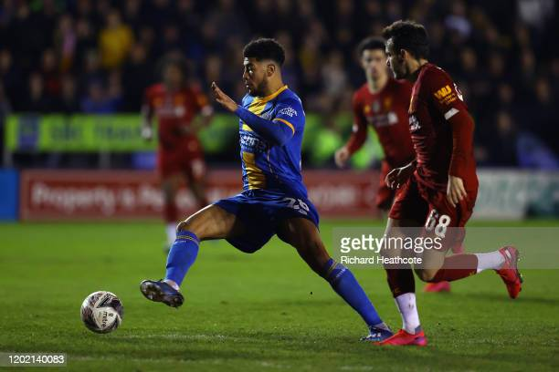 Josh Laurent of Shrewsbury goes past Pedro Chirivella of Liverpool during the FA Cup Fourth Round match between Shrewsbury Town and Liverpool at New...