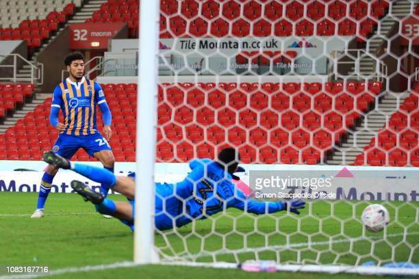 Josh Laurent of Shrewsbury scores their 3rd goal during the FA Cup Third Round Replay match between Stoke City and Shrewsbury Town at the Bet365...