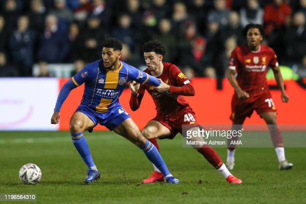 Josh Laurent of Shrewsbury Town and Curtis Jones of Liverpool during the FA Cup Fourth Round match between Shrewsbury Town and Liverpool at New...