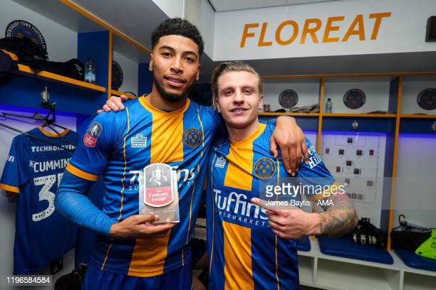 Josh Laurent of Shrewsbury Town and Jason Cummings of Shrewsbury Town celebrate with the man of the match trophy at full time in the dressing room...