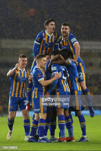 Josh Laurent of Shrewsbury Town celebrates after scoring a goal to make it 12 during the FA Cup Fourth Round Replay match between Wolverhampton...