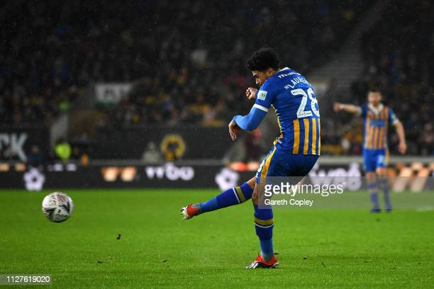 Josh Laurent of Shrewsbury Town scores his side's second goal during the FA Cup Fourth Round Replay match between Wolverhampton Wanderers and...