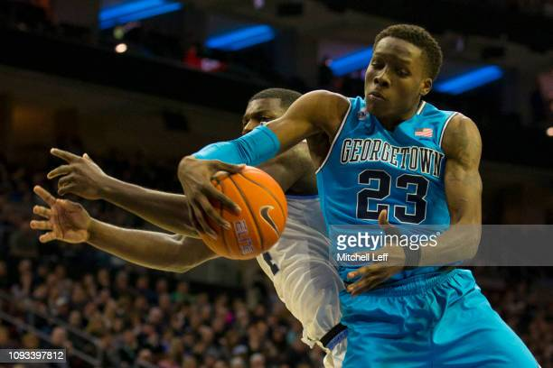 Josh LeBlanc of the Georgetown Hoyas grabs a rebound against Eric Paschall of the Villanova Wildcats in the first half at the Wells Fargo Center on...