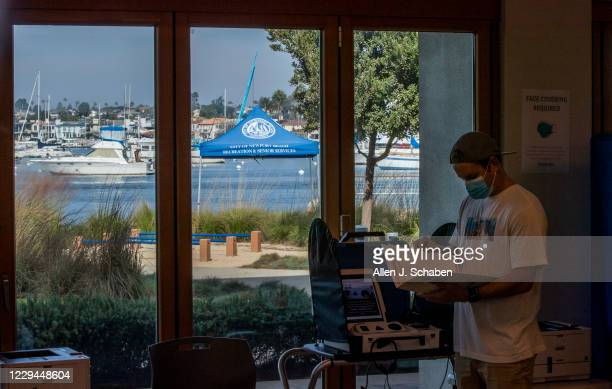 Josh Leith, of Newport Beach, has a scenic view of Newport Harbor while voting at Marina Park Community Center on election day Tuesday, Nov. 3, 2020...