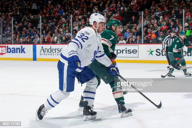 Josh Leivo of the Toronto Maple Leafs and Matt Cullen of the Minnesota Wild skate to the puck during the game at the Xcel Energy Center on December...