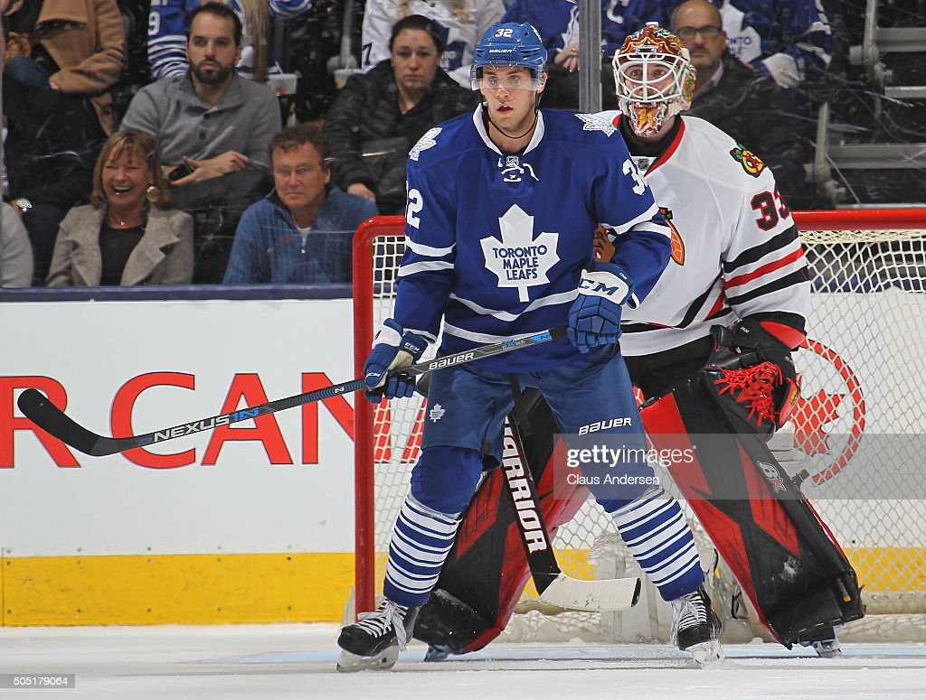 Josh Leivo #32 of the Toronto Maple Leafs waits for a shot to tip in front of Scott Darling #33 of the Chicago Black Hawks during an NHL game at the Air Canada Centre on January 15, 2016 in Toronto, Ontario, Canada. The Black Hawks defeated the Maple Leafs 4-1.