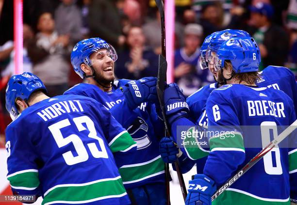 Josh Leivo of the Vancouver Canucks celebrates the goal of teammate Alexander Edler during their NHL game against the Los Angeles Kings at Rogers...