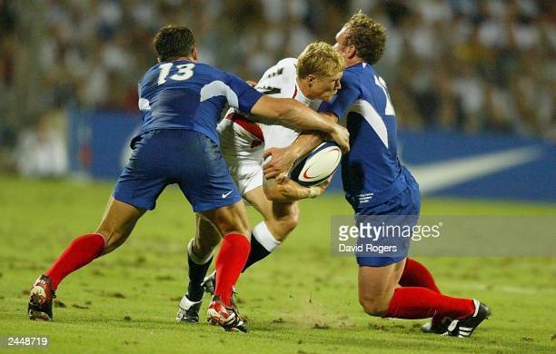 Josh Lewsey of England is stopped by Damien Traille and Yannick Jauzion of France during the Rugby Union International match on August 30 between...