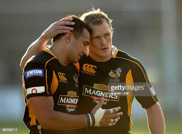 Josh Lewsey of London Wasps hugs team mate Riki Flutey during the Heineken Cup match between London Wasps and Castres Olympique at Adams Park on...