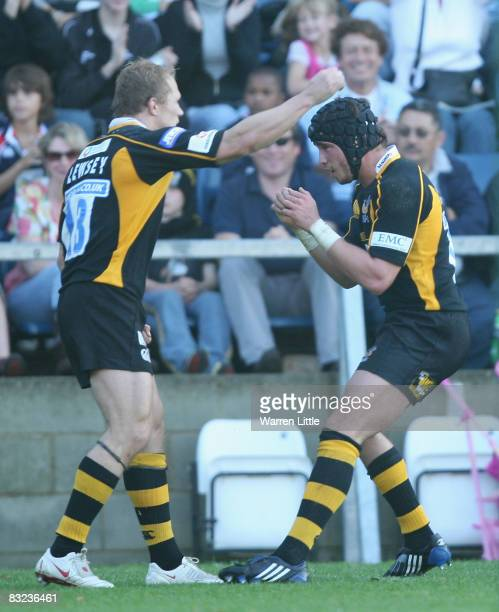 Josh Lewsey of London Wasps is congratulated by team mate Danny Cipriani after scoring a try during the Heineken Cup match between London Wasps and...