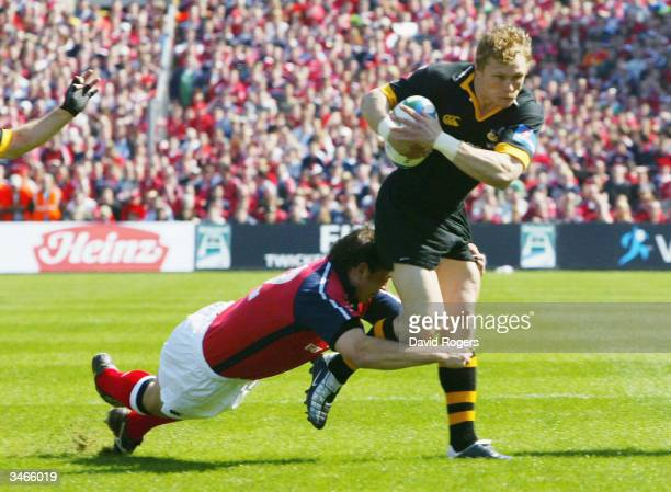Josh Lewsey of London Wasps is tackled by Rob Henderson of Munster during the Heineken Cup semi-final match between Munster and London Wasps at...
