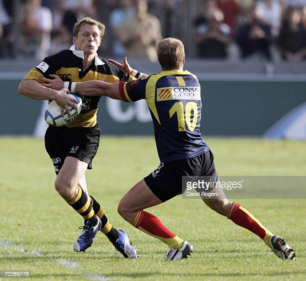 Josh Lewsey of Wasps is tackled by Steve Meyer during the Heineken Cup match between Perpignan and London Wasps at Stade Aime Giral on October 28...