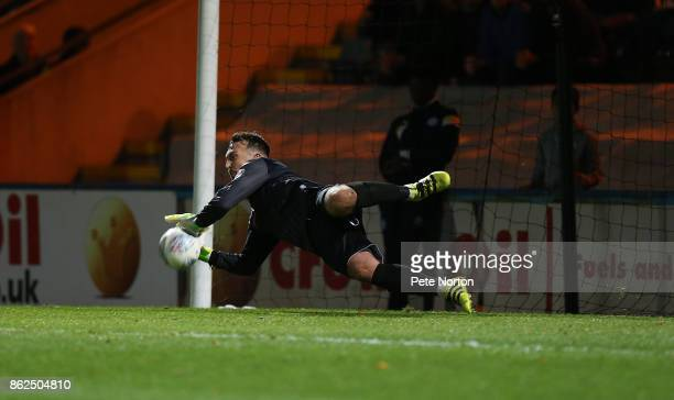 Josh lillis of Rochdale saves a penalty taken by JohnJoe O'Toole of Northampton Town during the Sky Bet League One match between Rochdale and...