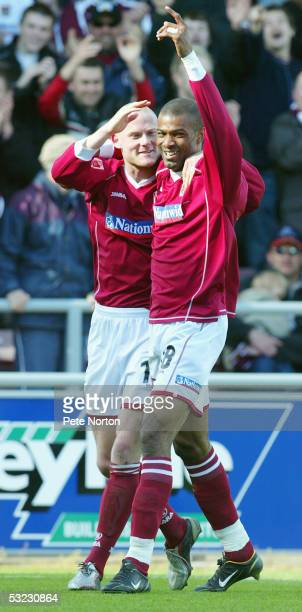 Josh Lowe and Eric Sabin of Northampton Town celebrate during the Coca Cola League Two match between Northampton Town and Kidderminster Harriers held...