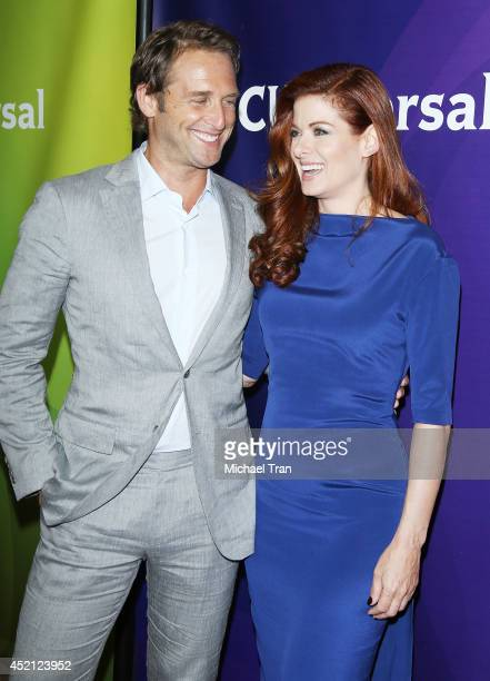 Josh Lucas and Debra Messing arrive at NBCUniversal's 2014 Summer TCA Tour Day 1 held at The Beverly Hilton Hotel on July 13 2014 in Beverly Hills...