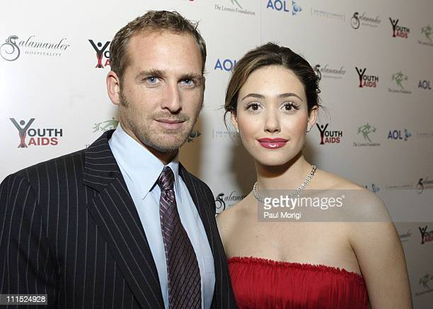 Josh Lucas and Emmy Rossum during Faces of Latin America 2006 YouthAIDS Gala at Ritz Carlton Tysons in McLean Virginia United States