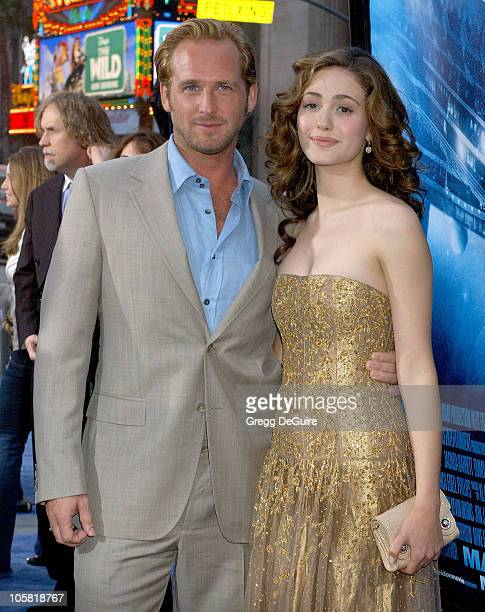 Josh Lucas and Emmy Rossum during 'Poseidon' Los Angeles Premiere Arrivals at Grauman's Chinese Theatre in Hollywood California United States