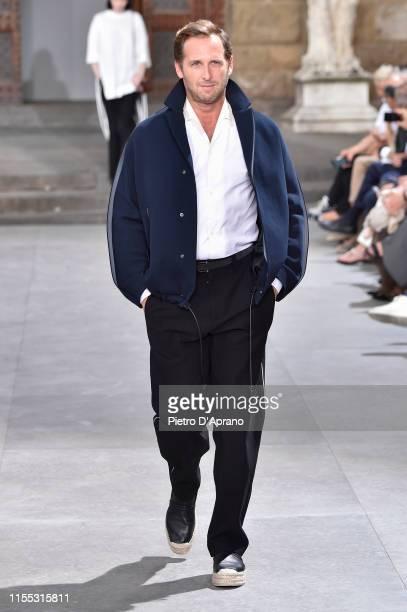 Josh Lucas walks the runway at the Salvatore Ferragamo fashion show in Piazza della Signoria during Pitti Immagine Uomo 96 on June 11, 2019 in...