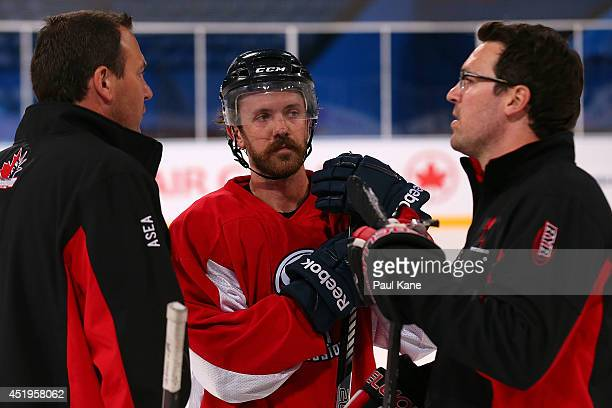 Josh Lunden of Canada talks with USA coach Keith Primeau and Canada coach Wayne Primeau during an International Ice Hockey Tour 2014 Media...