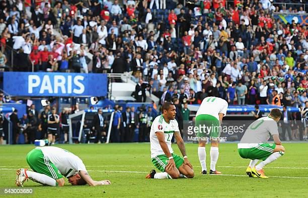 Josh Magennis and Northern Ireland players show their dejection after their team's 0-1 defeat in the UEFA EURO 2016 round of 16 match between Wales...