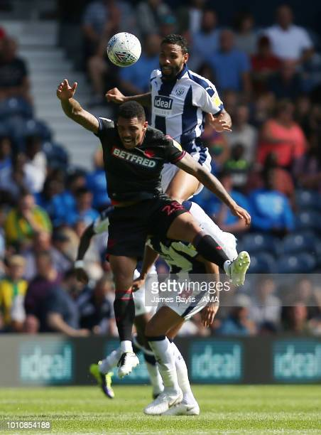 Josh Magennis of Bolton Wanderers and Kyle Bartley of West Bromwich Albion during the Sky Bet Championship match between West Bromwich Albion and...