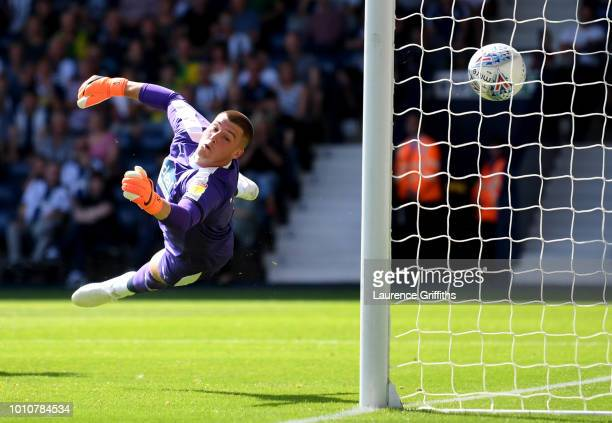 Josh Magennis of Bolton Wanderers scores his team's first goal past Sam Johnstone of West Bromwich Albion during the Sky Bet Championship match...