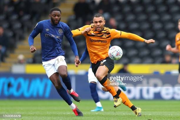 Josh Magennis of Hull City battles with Joshua Da Silva of Brentford FC during the Sky Bet Championship match between Hull City and Brentford at KCOM...