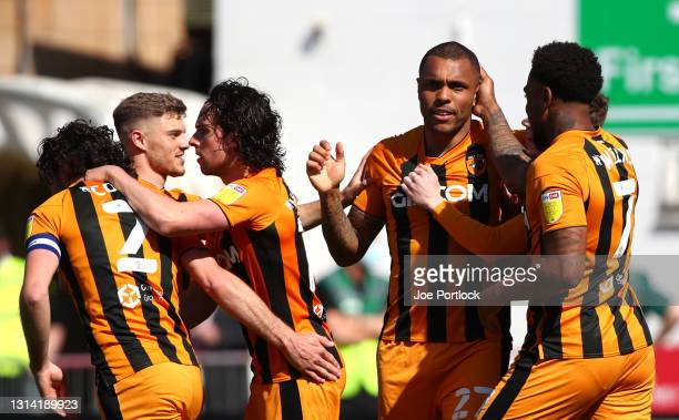 Josh Magennis of Hull City celebrates after scoring their sides first goal with team mate Mallik Wilks during the Sky Bet League One match between...