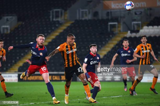 Josh Magennis of Hull City shoots during the Sky Bet League One match between Hull City and Sunderland at KCOM Stadium on April 20, 2021 in Hull,...