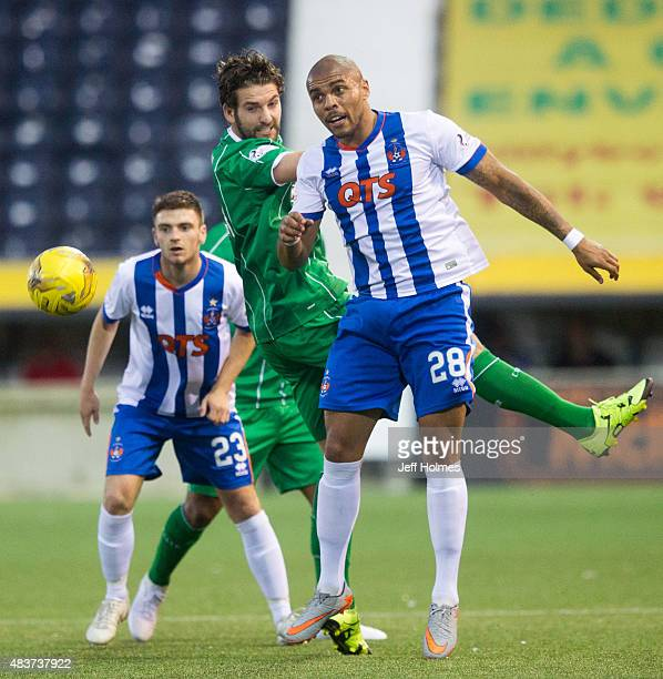 Josh Magennis of Kilmarnock and Charles Mulgrew of Celtic compete for the ball during the Scottish premiership match between Kilmarnock and Celtic at...