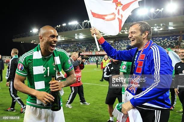 Josh Magennis of Northern Ireland and Northern Ireland goalkeeper Roy Carroll celebrate victory and qualification after the UEFA EURO 2016 Qualifying...