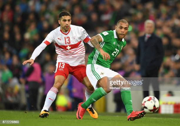 Josh Magennis of Northern Ireland and Ricardo Rodriguez of Switzerland in action during the FIFA 2018 World Cup Qualifier PlayOff First Leg between...