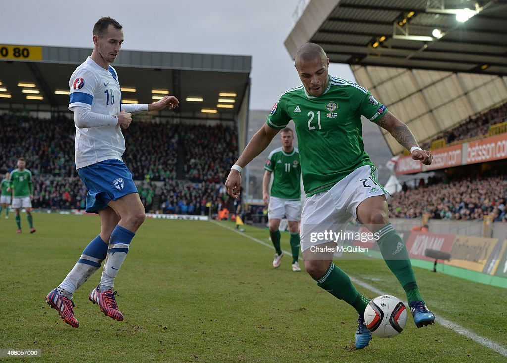 Josh Magennis (R) of Northern Ireland and Sakari Mattila (L) of Finland during the EURO 2016 Group F qualifier at Windsor Park on March 29, 2015 in Belfast, Northern Ireland.