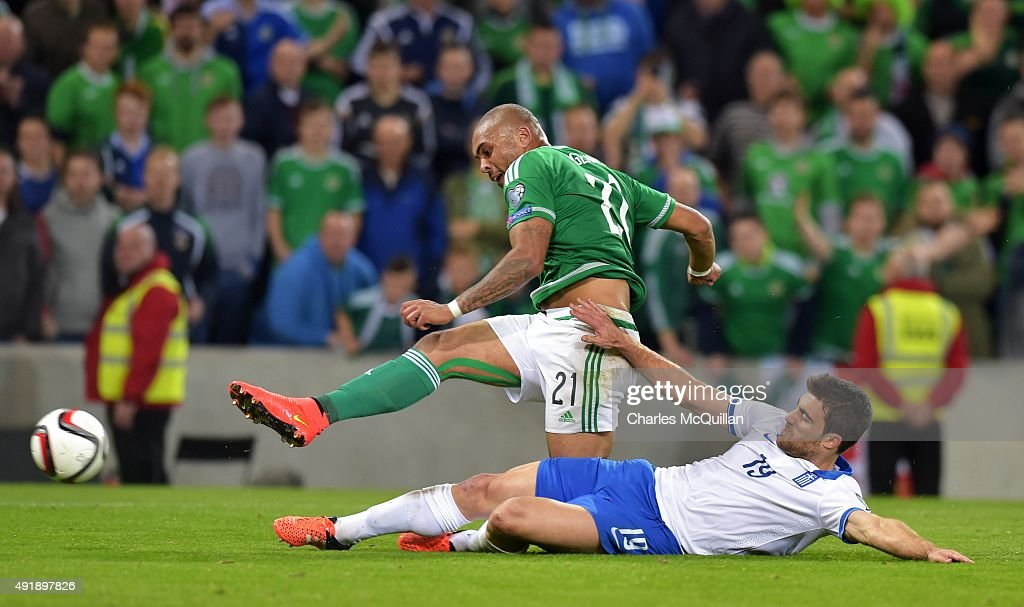 Josh Magennis of Northern Ireland (L) and Sokratis Papastathopoulos of Greece (R) during the Euro 2016 Group F international football match at Windsor Park on October 8, 2015 in Belfast, Northern Ireland.