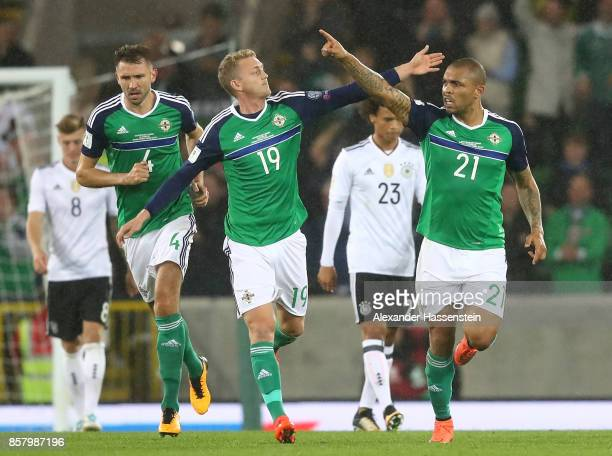 Josh Magennis of Northern Ireland celebrates scoring his goal with George Saville during the FIFA 2018 World Cup Qualifier between Northern Ireland...