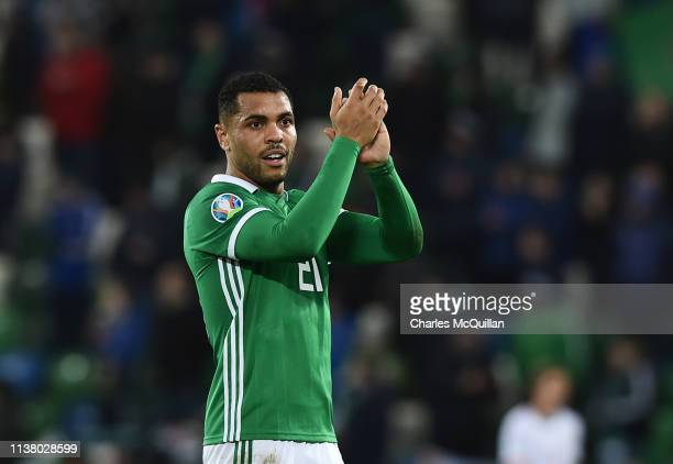 Josh Magennis of Northern Ireland celebrates victory after the 2020 UEFA European Championships Group C qualifying match between Northern Ireland and...