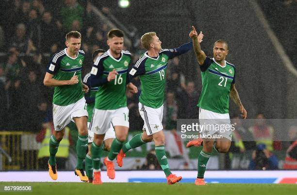 Josh Magennis of Northern Ireland celebrates with team mates after scoring during the FIFA 2018 World Cup Qualifier between Northern Ireland and...