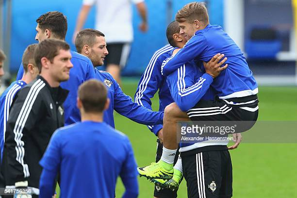 Josh Magennis of Northern Ireland jokes with his team mate Jamie Ward during a team Northern Ireland training session ahead of the UEFA EURO 2016...