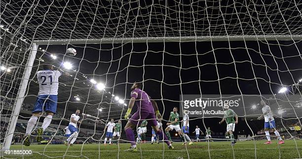 Josh Magennis of Northern Ireland scores with a header during the Euro 2016 Group F international football match against Greece at Windsor Park on...
